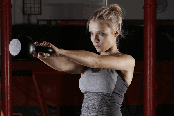 attractive lady doing kettlebell swings