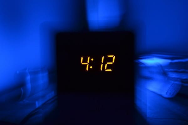digital alarm clock at 4:12am in the morning representing insomnia