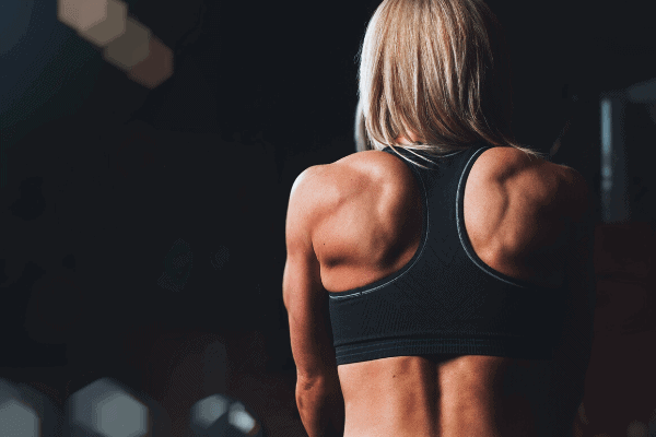 strong lady showing her back muscles