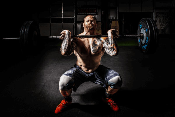 strong man doing front squat