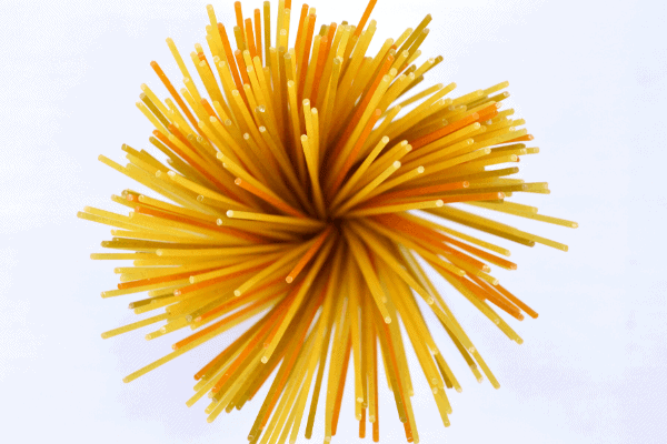 birds eye view of uncooked spaghetti pasta twisted together
