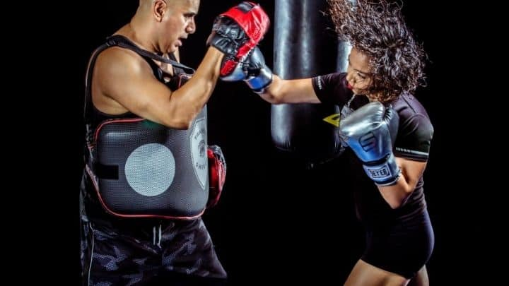 Boxing tips everyone should know featuring two people on the pads.