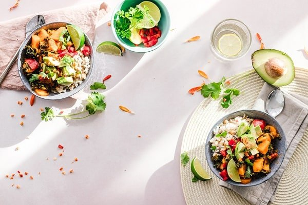Two healthy dishes separated representing an individual meal frequencies.