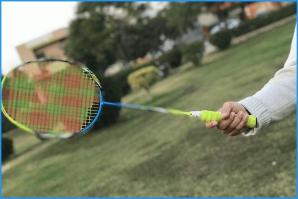 A badminton player holding his racquet in the forehand grip