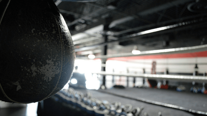A well used speed bag close up in a boxing gym